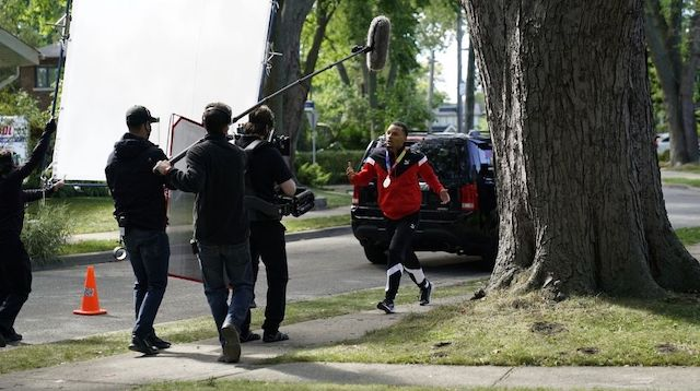 Andre De Grasse walking on the street while being filmed