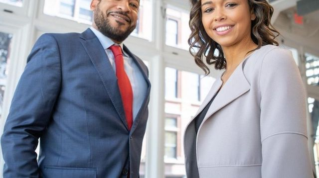 Business Man and Woman Standing in an Office Building