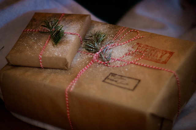 Holiday packages wrapped with red string and snow