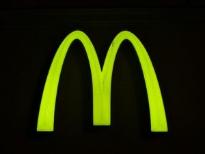 Mcdonald's Golden Arches Logo Against Black Background