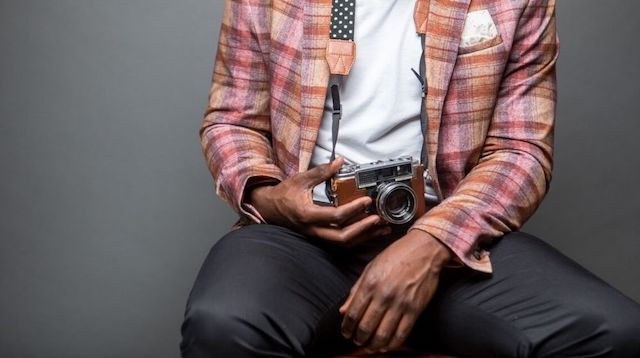 Affiliate Marketing Man Holding Camera