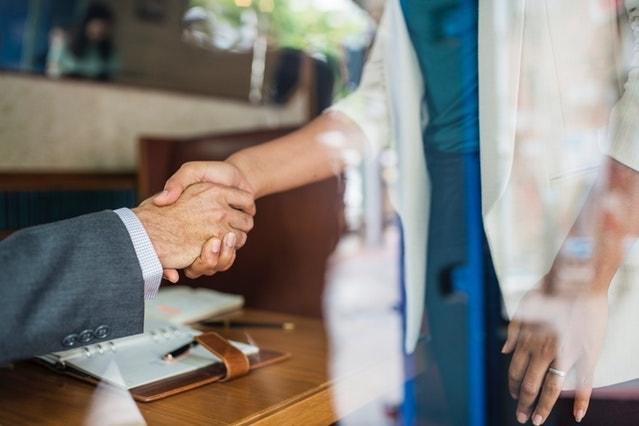 Classified Balance Sheet Woman and Man Shaking Hands