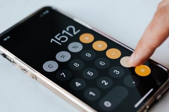 Closeup of a person using a calculator app