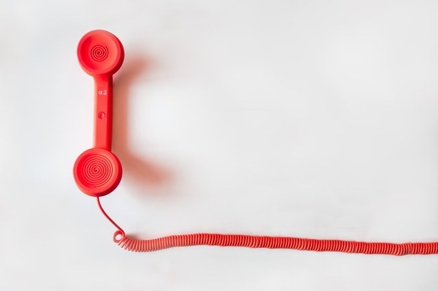 Communication Strategy Red Landline Phone Receiver