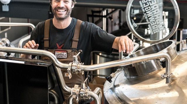 Corporation Tax Smiling Man on Brewery Floor