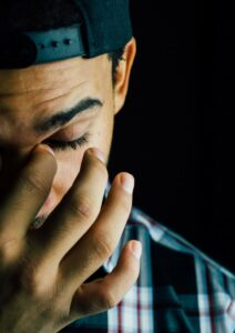 Employee Assistance Program Man Rubbing Eyes