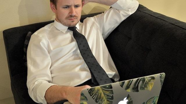 Employee Benefits Man Working on Laptop
