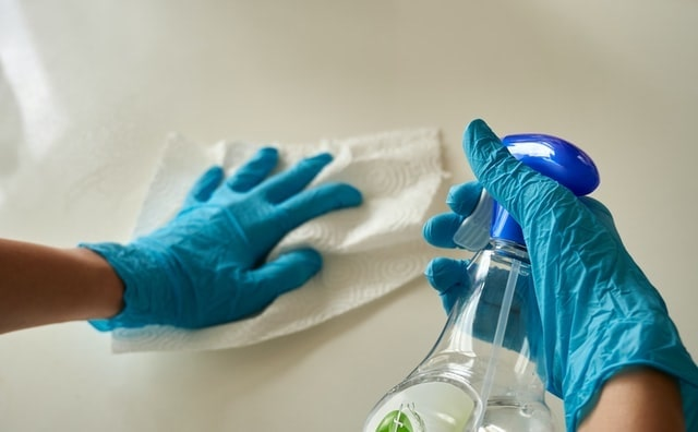 Employee Motivation Person Sanitizing a Counter