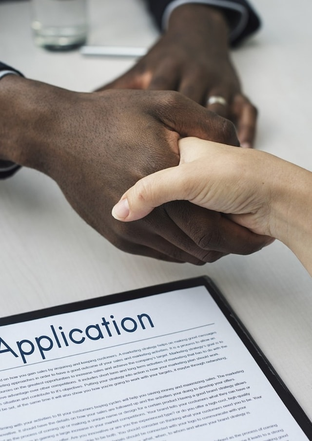 Employment Contract Two People Shaking Hands