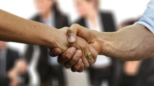 Angel Investors Two People Shaking Hands