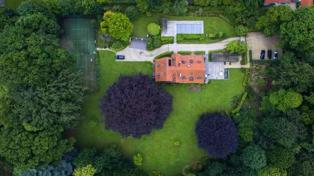 Overhead View of Large House in Wooded Setting