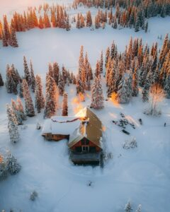 Overhead view of snow-covered cabin