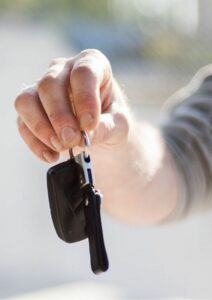 Passive Income Ideas Man with Car Key