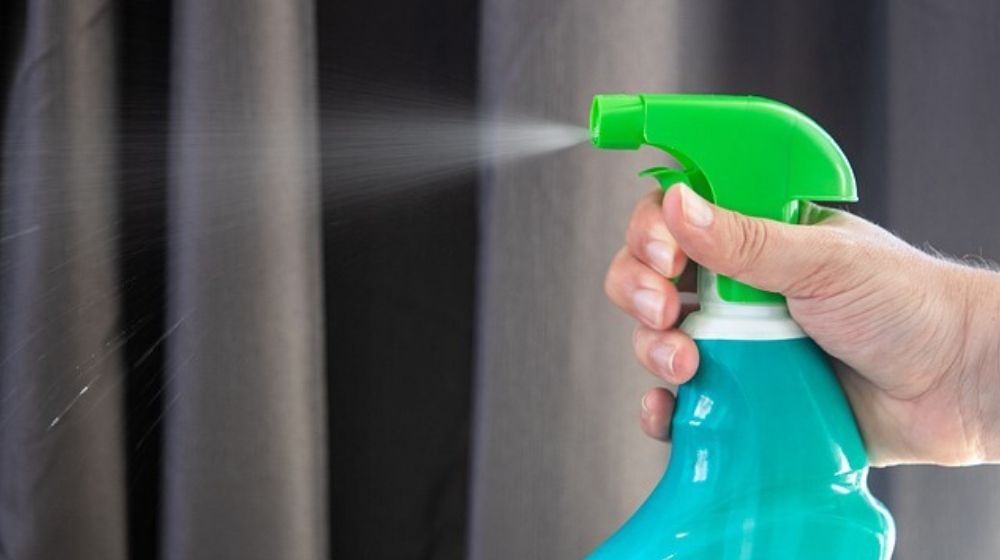 Person Spraying Disinfectant