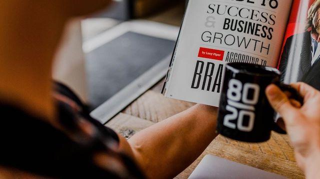 Real Estate Broker Person Reading Magazine