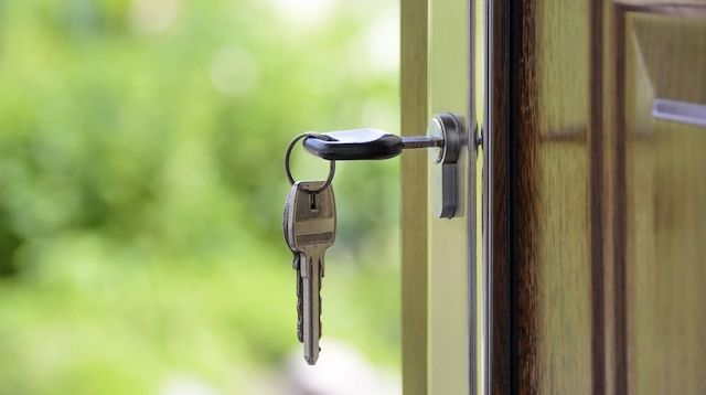 Real Estate Courses Key Hanging in Lock