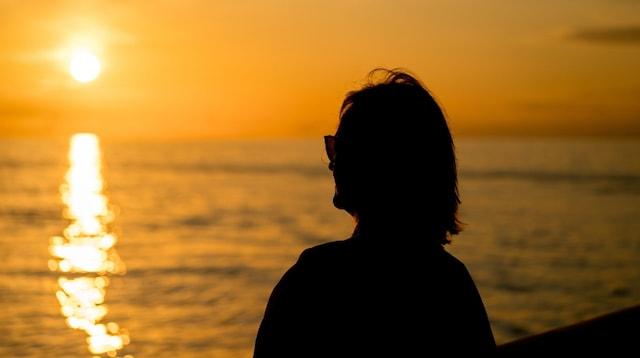 Retirement Planning Woman Watching Sun Set