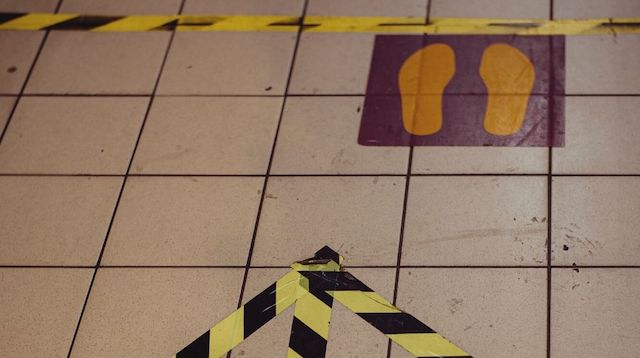 Tape on Floor Showing Social Distance