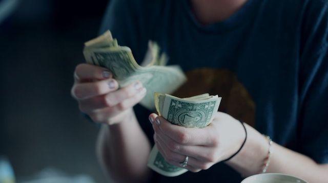 Trial Balance Woman Counting Dollar Bills