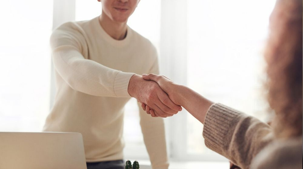 Web Design Company Man and Woman Shaking Hands