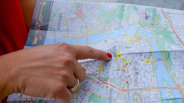 Woman Pointing to a Spot on a Map
