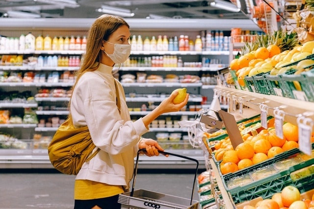 Woman Wearing Mask While Shopping in Grocery Store