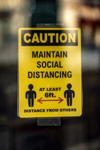 Yellow and Black Caution Social Distance Sign