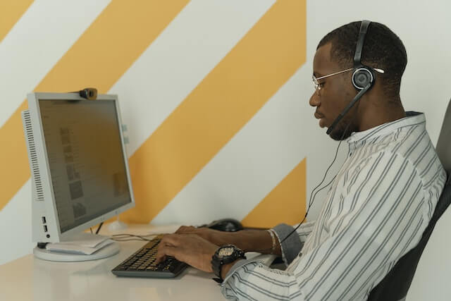 Call center agent working on desktop computer