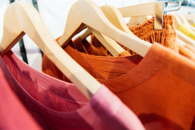 Colorful clothing hanging on a rack.