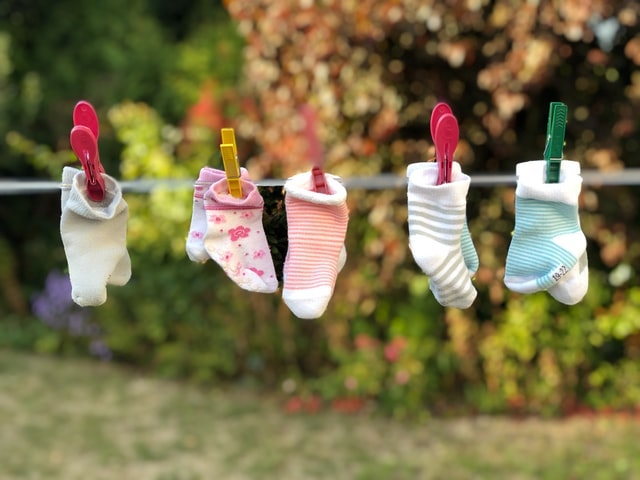 Closeline with pairs of baby socks clipped to it