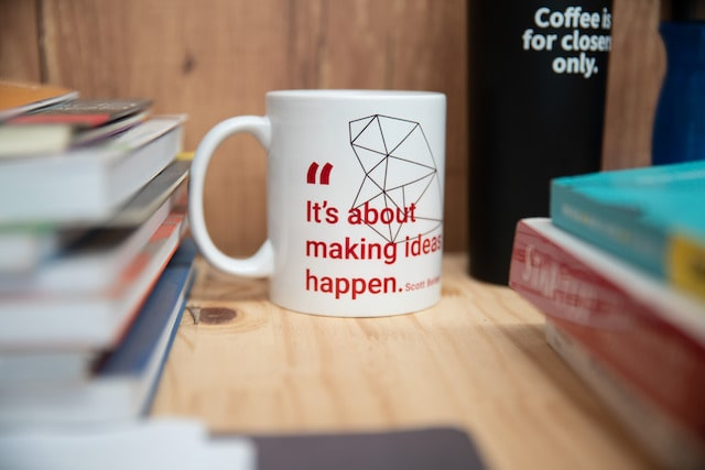 "Coffee mug that says ""It's about making ideas happen"""