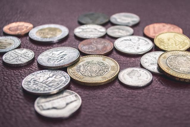 Global coins spread out on table