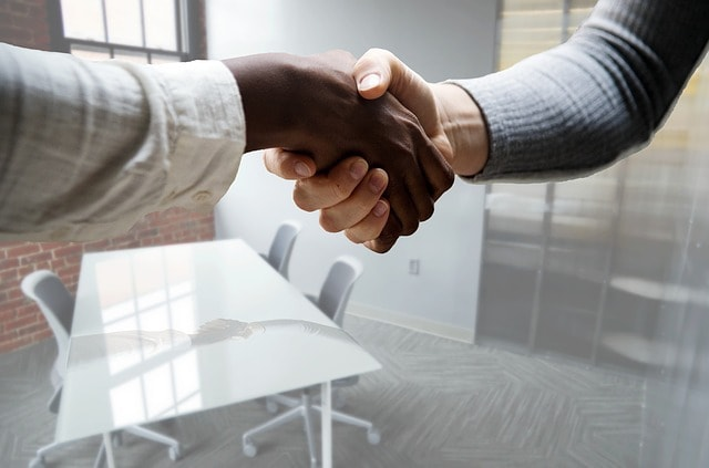 How to Write a Job Description Women Shaking Hands