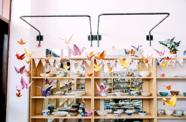 Origami cranes hanging inside an art shop