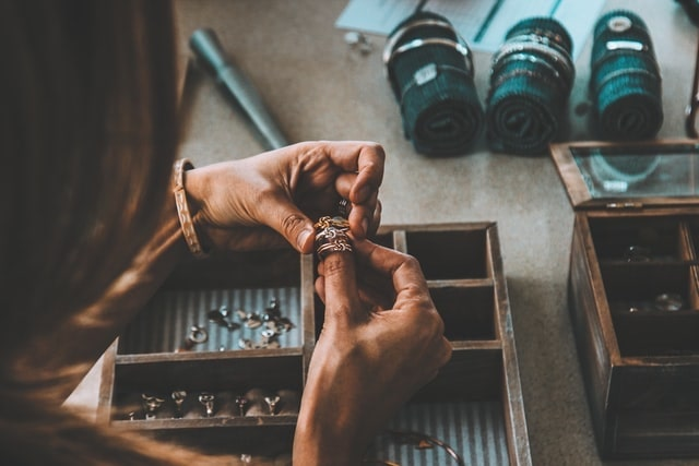 Woman comparing three handmade rings